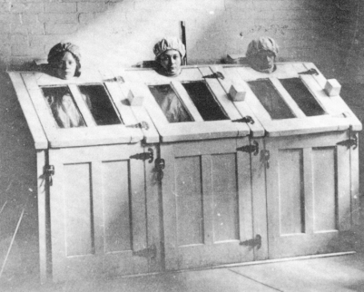 Insane patients in steam cabinets, c 1910.